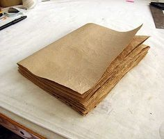 great tutorial to make books out of grocery bags... interesting methodology to get her great paper texture