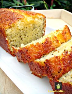 Moist Lemon & Poppy Seed Loaf. A wonderful gentle flavored, soft cake, perfect with a cup of tea! #cake #lemon #poppyseeds #baking