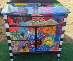 Cabinet of Chaos- hand painted cabinet using acrylic and 5 coats of resin for a durable top.