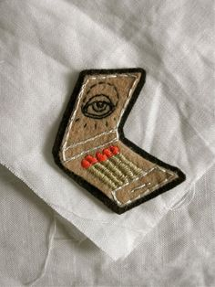 Hand Embroidered Matchbook Patch/Brooch by eradura on Etsy, $16.00: