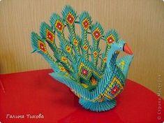 Для создания такой жар-птицы мне потребовлось:1225 модулей (772 голубых, 345 жёлтых, 96 красных, 11 белых и 1 чёрный) фото 1
