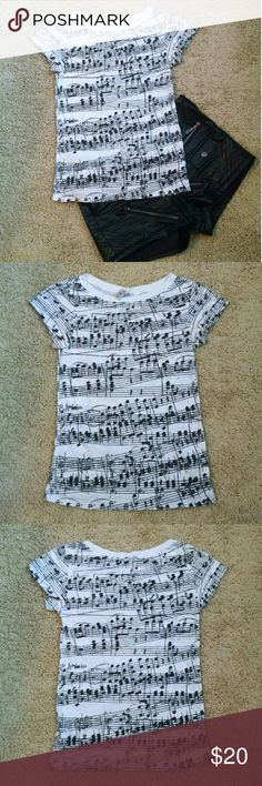 Distressed Sheet Music Tee This 100% cotton tee features an all over distressed Sheet music print. It is so soft and comfortable, it is the perfect addition to your weekend wardrobe! The bottom hem and the hem of the sleeves are a very subtle light purple color, as can be seen in the last photo. This tee is pre-loved, so may show signs of gentle wear, but has no visible imperfections. In great condition! Tops Tees - Short Sleeve