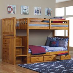 """Add style and function to your children's bedroom with this twin-over-twin staircase bunk bed in a rich honey finish! The ready-to-assemble unit features a built-in, four-drawer chest and reversible staircase, magazine rack, and three-drawer under-bed storage unit. The stair treads are 17.25"""" wide for a safe climb to the upper bunk. Quality with solid-wood construction makes this bunk bed a great buy."""