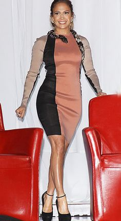 I'm not a fan of this dress, but this style showdown still needs to be called! It's a rare occasion when the stylish J.Lo doesn't look hot, especially when she's rocking a garment that hugs her in all the right places. The fact that she's wearing a fake snake just looks silly to me.