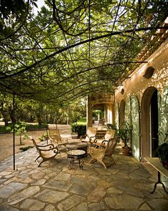 what's not to love under the wisteria's dappled shade in summer? i love the generous width of the terrace - nothing worse than guests toppling off the edge or having the squeeze past someone else. I love the graceful curve of the steel - in winter when the leaves are gone the sculptural lines compliment the furniture curves.