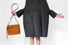 Love the Ally Cappellino bag and that bubble coat. Still waiting for spring here!