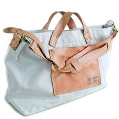 I like this...leather and canvas collision with optional shoulder strap