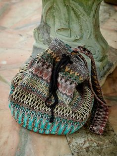 This boho beach bag will fit everything from your sunscreen to your wallet! It's lined and features a cord closure.