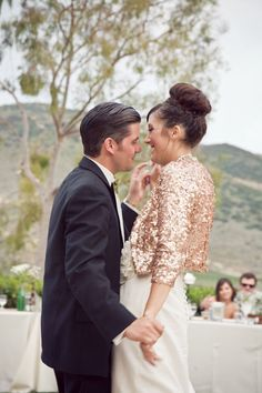 love how this bride rocked a gold sequined 3/4 blazer over her wedding gown.