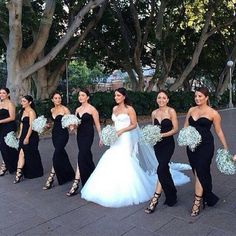 Sweetheart black bridesmaid dresses with baby breath bouquet and bride
