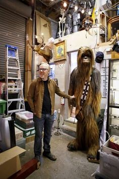 Everyone loves a Wookiee, Savage says, displaying his cherished Chewbacca costume in the Cave. He goes as Chewbacca - or whatever else comes to mind - to places like the Comic-Con. Photo: Russell Yip, The Chronicle