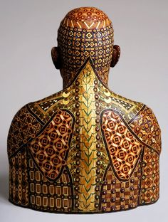 """head and shoulders figure Sam---2005 recycled wood/ pigmented grout 42""""x33""""x16"""" Michael Ferris Jr."""