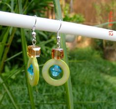 These are cute glass like circle beads along with swarovski crystal accents.  Cute anytime earrings.