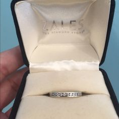 14kt White Gold Ring 14KT white gold ring with 13 diamonds. This is 14kt solid gold from Zales. Size 5 3/4. Keep in mind you are able to get it re-sized up or down a half size since its 14KT gold. Zales Jewelry Rings