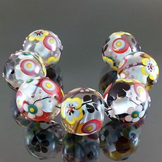 PIKALDA=handmade lampwork 7 glass beads flower blossom=BLACK LEAF=SRA