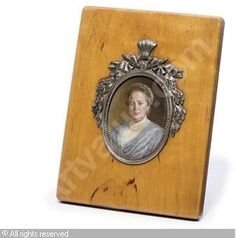 FABERGÉ Karl (Carl), 1846-1920 (Russia) Title : A frame with miniature Date : ca 1915   Category : Works of Art Medium : : Silver-mounted, wood, rectangular, birch-wood frame, containing the miniature by V. I. Zuev depicting Mrs Edla Nobel, the oval apperture with beaded b...