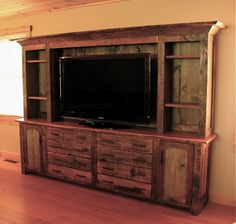 rustic entertainment center, barn wood furniture... I want it!