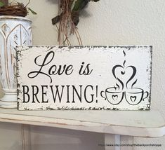 LOVE IS BREWING How sweet is this...a self standing LOVE IS BREWING sign! This elegant little sign is done in distressed & aged VINTAGE SOFT IVORY with aged BLACK lettering, and is 5.5 high x 11.5 long. Perfect sign for your COFFEE or BEER BAR........or even for your SAVE THE DATE