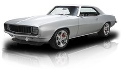 With a massaged LS3, a tough Tremec Magnum and a roster of updated ancillaries that includes names like, Detroit Speed, Truetrac and QA-1, this impressive Camaro definitely has the merit to back up its cool presence! The beneficiary of a 7-year, ground-up restoration that was completed in October of 2014, this sterling pony car is the product of filler-free, all-original sheetmetal and A LOT of time spent sweating details. From its straight panels to its Nissan Silver Crystal Metallic…