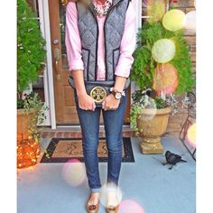 I love the pink button-down with the herringbone puffer; this is how you make a puffer vest look girly!