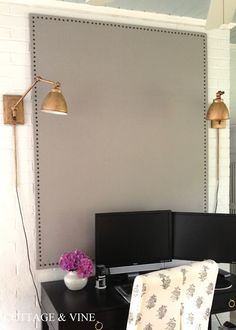 DIY Bulletin Board made from homasote, canvas and upholstery tacks. Could also use burlap.