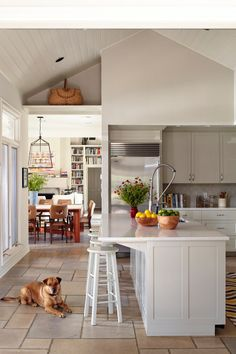 modern white and taupe kitchen, tile floor