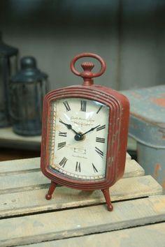 metal table clock-red.has a vintage look
