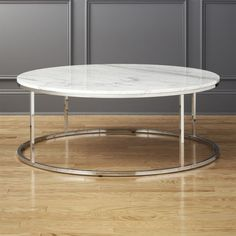 Shop Smart Large Round Marble Top Coffee Table.   Sized up for large spaces, open cylinder construction of slick polished chrome tops out in Carrara-style white/grey marble.  Smooth and cool with a subtle silvery glint of crystallization.  Sits just 17.