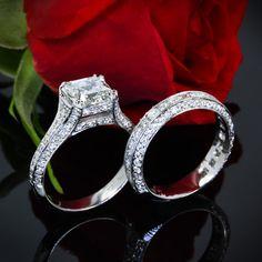 Platinum engagement ring is showcasing a 1.94 G VS1 Asscher set with 22 Asscher cut diamonds and 60 A Cut Above Melee diamonds.