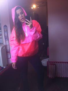 Girl in pink nylon cagoule