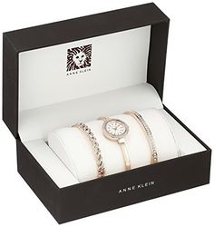Anne Klein Women's AK/2046RGST Analog Display Japanese Quartz Rose Gold Watch  Anne Klein Women's AK/2046RGST Analog Display Japanese Quartz Rose Gold Watch Boxed set includes a rose gold-tone timepiece and two bracelets. Stainless steel case back. Rose gold-tone bracelet with jewelry clasp closure. Crystal charms and embellishment on bracelets. Round face with crystal-embellished bezel. Three-hand analog display with quartz movement. Dial features rose gold-tone hands and hour marke..