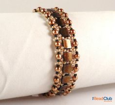 Make this bracelet using Tila beads, 3mm pearls and seed beads! Purchase video tutorials/ PDFs from our website: www.thebeadclublounge.com Follow us on: Face...