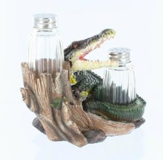 .  Alligator Salt and Pepper Shaker Set from DWK products.  Made from hard, durable poly resin.   Two glass shakers included!