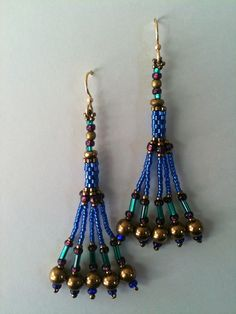 Cobalt, teal & purple fringe earrings by Jeka Lambert.  Seed bead woven.  Seed beads, glass beads.  Available at the Volcano Art Center Gallery, Hawaii.