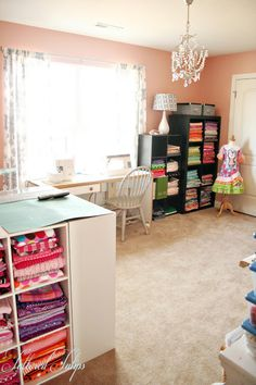 Sewing room. Great way to organize fabric and get a cutting board all in one.