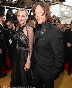 It's official!Diane Kruger and Norman Reedus made their red carpet debut as a couple at the 75th annual Golden Globe awards at The Beverly Hilton in Los Angeles on Sunday