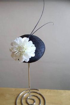 Check out this item in my Etsy shop https://www.etsy.com/uk/listing/510599174/flower-ascot-hat-fascinator