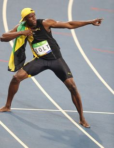Usain Bolt of Jamaica celebrates after winning the gold medal in the Men's 100 meter final of the Rio 2016 Olympic Games in Rio de Janeiro Brazil on...