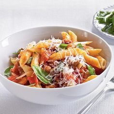 Fresh Tomato, Sausage, and Pecorino Pasta | Ripe, summer tomatoes are juicy and delicious in this pasta dish, with no seeding or peeling necessary. | Cooking Light