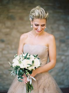 Classic white rose bouquet: http://www.stylemepretty.com/2016/07/14/forget-catching-pokemon-catch-these-wedding-bouquets-instead/