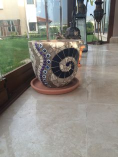 Mosaic pot made from leftover ceramic tiles.