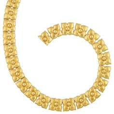 Hammered Gold Necklace, Tiffany & Co., Paloma Picasso  18 kt., composed of hammered gold stylized flower links, centering polished gold domes, signed Tiffany & Co., Paloma Picasso, Italy, approximately 94.7 dwts. Length 17 5/8 inches.