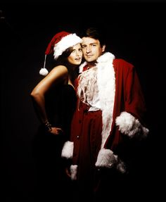 Nathan Fillion and Stana Katic wishing you Happy Holidays from The Castle, high atop the Hotel Sheets!