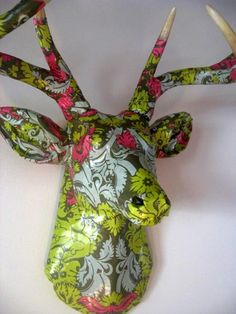 Decoupage deer head. Paper mache over cast resin. What a great idea. I want.