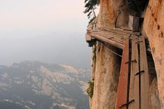 Mount Hua Shan climb in China: Climb Mount Hua Shan, China  It starts gentle enough, this climb up a mountain in rural Shaanxi, China. But then all of a sudden you find yourself clingi...