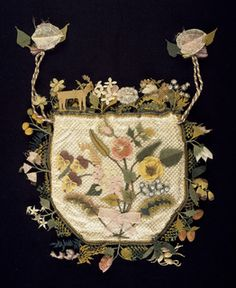 Flat purse with a drawstring top; one face has a bouquet of flowers, the  other a basket of flowers. The sides and top are decorated with a deep  edging of ...