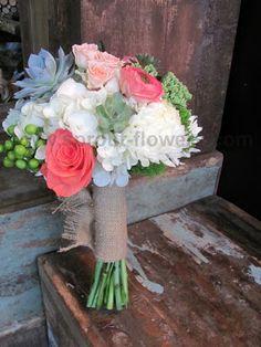 Succulent, hydrangea rose, spray rose, hypericum, and ranunculus bridal bouquet with burlap stem wrap.