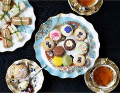 How about some Royal Bejeweled Afternoon Tea with glittering array of petit fours, tarts,biscuits, truffles, jeweled lavender cupcakes with Royal blend tea!!