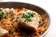 Striped bass or mahi mahi with fennel, leeks and tomatoes. This fish recipe follows the Seafood Watch program recommendations.