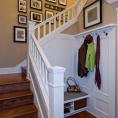 I love this foyer idea, and the photos going up the stairs